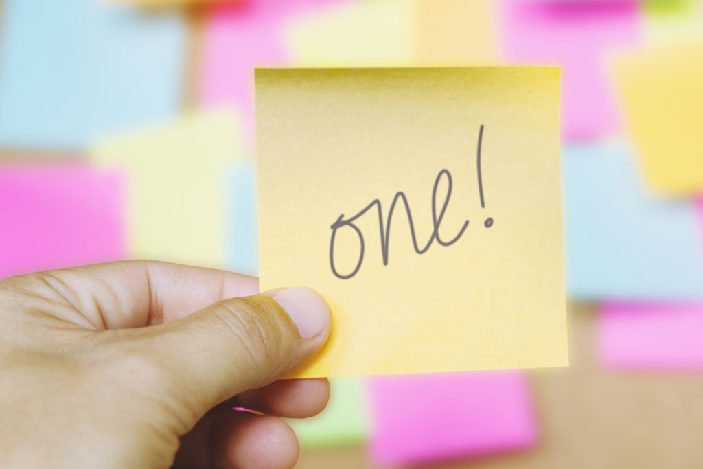 Image of a Post-it with one! written on it